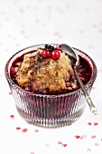 Red fruit crumble in a glass bowl