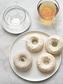 Four White Chocolate Covered Doughnuts; One with Coconut