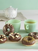 Chocolate Covered Donuts with Assorted Toppings; Pistachios, White Chocolate and Almonds
