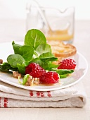 Lamb's lettuce with a raspberry vinaigrette and walnuts
