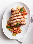 Grilled swordfish steak with tomato sauce