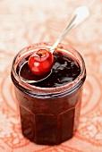 Cherry jam in a screw top jar