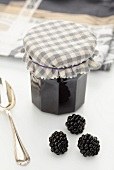 Blackberry jam and fresh blackberries