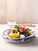 A colourful country salad with edible flowers