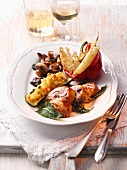 Chicken steaks with vegetables and stuffed courgette