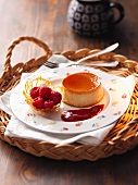 Crème caramel with a caramel basket and raspberries
