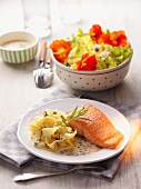 Salmon fillet with tagliatelle and a colourful salad