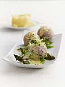 Veal dumplings with lemon sauce and asparagus