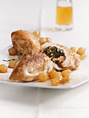 Stuffed chicken breast with plums and pearl onions