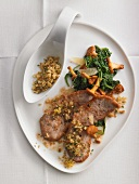 Scaloppine with chanterelle mushrooms and spinach
