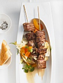 Grilled lamb kebabs with a carrot and fennel salad