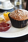 A bran muffin with jam