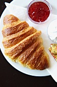 A croissant, jam and butter