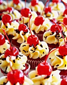 Mini red velvet cakes decorated with cocktail cherries