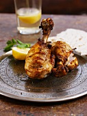 Tandoori chicken on a plate with unleavened bread (India)