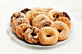 Variety of Bagels on a Platter; White Background