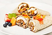 Burritos on a White Plate; Fresh Fruit