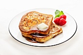 Cinnamon Swirl French Toast with Butter and Maple Syrup