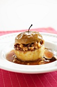Stuffed Baked Apple in a Shallow Bowl; Spoon