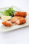 Crispy Salmon Cakes on a Plate with Lemon