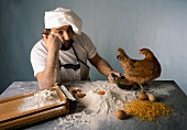 Wartender Koch mit Huhn