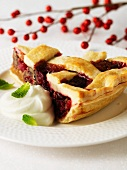 A slice of cranberry and pecan pie