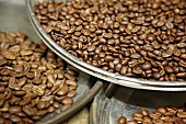 Coffee beans in metal dishes