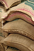 A stack of jute sacks with coffee beans