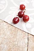 Red gooseberries on a batik cloth