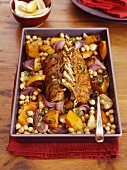 Spicy saddle of lamb with roast pumpkin and chickpeas in the roasting tin