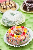 Frosted Doughnut with Sprinkles and Candies; Assorted Doughnuts