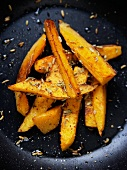Roasted sweet potato wedges in a pan