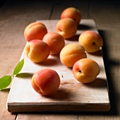 Apricots on a wooden board