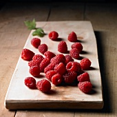 Raspberries on a wooden board