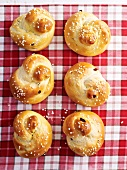 Knotted bread rolls on a checked cloth