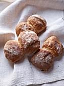 Swiss bread rolls on a linen cloth