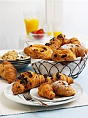 Croissants, pastries, cereals and orange juice