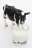 A glass of milk and a cow figurine