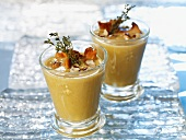 Cream of pumpkin soup with nuts and chanterelle mushrooms