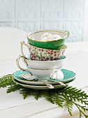 A stack of Christmas tea cups