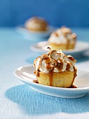 Almond meringue cakes with caramel sauce