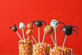 Halloween Cake Pops in Containers Filled with Candy Corn
