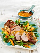 Marinated roasted veal with spring vegetables
