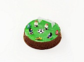 A birthday cake decorated with football motifs