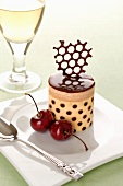 Berry and chocolate mousse cake with cherries