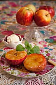 Baked apple halves with vanilla ice cream