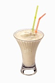An ice cream shake with two straws