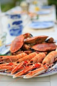 Crabs and langoustines on a table laid for a meal