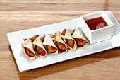 Mini wraps with barbecue sauce