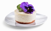 Mini French Vanilla Cheesecake with Purple Flower Garnish